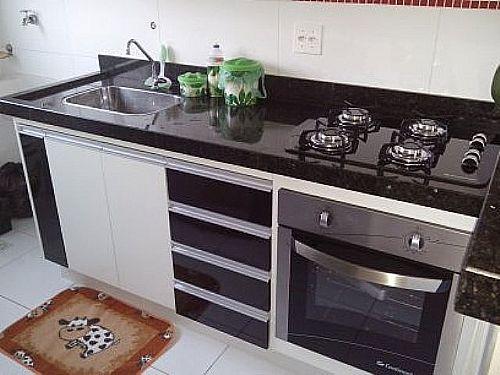 cozinha planejada com fogão cooktopIdéias de decoração para casa